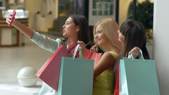 Happy Purchases, Company Shopper Women Take Selfie Photos on Telephone While Shopping with Packages