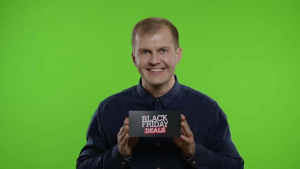 Man Smiling and Showing Black Friday Deals Inscription, Rejoicing Discounts, Online Shopping Sales