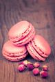 Macaroons with dry roses on retro vintage wooden background - PhotoDune Item for Sale