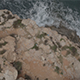 Rocky Coast and Sailboat out at Sea, Aerial Drone - VideoHive Item for Sale