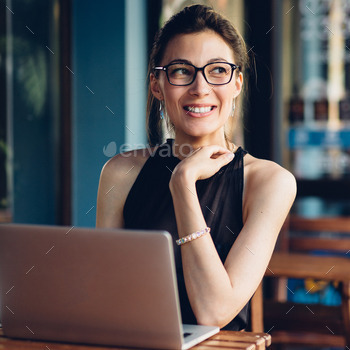 Attractive business woman working at his laptop