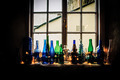 Coloured Bottles on a Window Sill - PhotoDune Item for Sale