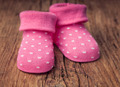 Baby girl shoes for a baby shower on vintage wood - PhotoDune Item for Sale