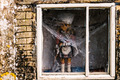 Creepy Doll Covered in Webs in a Window - PhotoDune Item for Sale