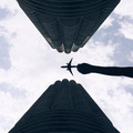 Looking up Tall buidings with A Hand Holding a Toy Flight - PhotoDune Item for Sale