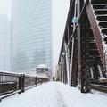 A Man Walking on a Bridge In Snowstorm - PhotoDune Item for Sale