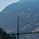 Seaplane Flies Over Busy Bridge Near Mountains - VideoHive Item for Sale