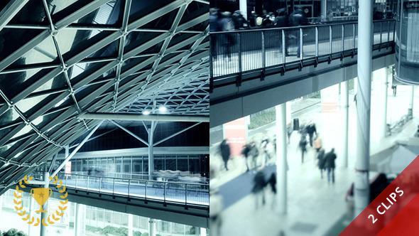 People Walking in Futuristic Architecture