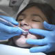 Dentist Polishes Young Girl Teeth - VideoHive Item for Sale
