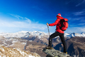 Hiker takes a rest admiring the mountain landscape. - PhotoDune Item for Sale