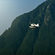 Small Plane Flies Past Forest Mountainside - VideoHive Item for Sale