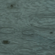 Rain Drops Falling on Car Windshield