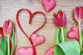 heart-shaped macaroons with flowers and ribbon on a wooden table. - PhotoDune Item for Sale