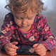 A Little Girl Watching Cartoons on the Tablet - VideoHive Item for Sale