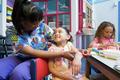 Nurse bandaging girls arm - PhotoDune Item for Sale