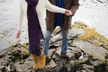 Mature couple climbing rocks - PhotoDune Item for Sale
