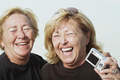 Laughing women with digital camera - PhotoDune Item for Sale