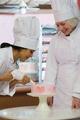 Baker decorating cake - PhotoDune Item for Sale