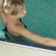Charming Girl In a Black Bikini Relaxing In Swimming Pool - VideoHive Item for Sale