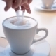 Female Hand With Cup Of Coffee In a Coffee Shop - VideoHive Item for Sale