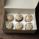 Hands Close a Box Of Cupcakes - VideoHive Item for Sale