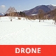 Aerial View of a Snowy Valley from Above in a Sunny Day - VideoHive Item for Sale