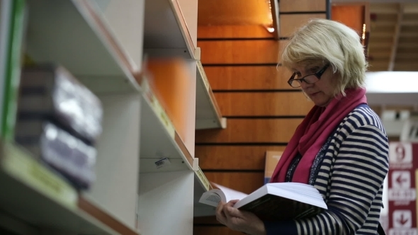 Blonde Woman Browsing Books In a Bookstore