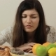 Woman Deciding Between Fruits And Cakes - VideoHive Item for Sale