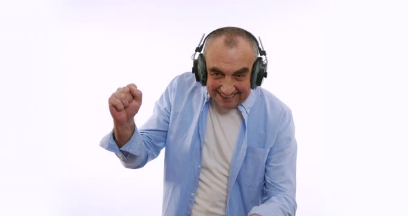 The Old Man in Headphones, Listening To Music, Dancing, Smiling, Cheerful. A Very Funky Elderly