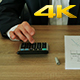 Businessman Checks the Calculations on a Calculator  - VideoHive Item for Sale