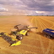 The Harvester and the Truck Reaching the End of the Field - VideoHive Item for Sale