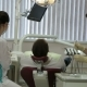 Young Dentist And His Assistant Treat Teeth Middle-aged Man - VideoHive Item for Sale