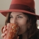 Young Woman In Hat Drinks Coffee - VideoHive Item for Sale