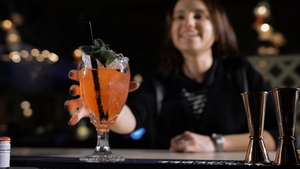 The Bartender Puts An Exclusive Cocktail For The Attractive Brunette