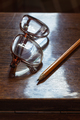 Old pensioner glasses on lacquered wooden surface. Blurred vision of old age - PhotoDune Item for Sale