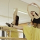 Girl Posing On One Leg At Ballet Barre - VideoHive Item for Sale