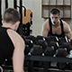 Muscular Athlete Trains with Dumbbells - VideoHive Item for Sale