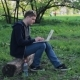 Young Man Working On Laptop In The Park - VideoHive Item for Sale