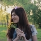 Pretty Young Woman Smiling And Smelling Flowers In The Park - VideoHive Item for Sale