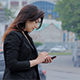 Woman With Smartphone Walking in the City at Sunset - VideoHive Item for Sale