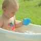 Cute Toddler Having a Bath in Garden - VideoHive Item for Sale