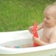 One Year Old Kid Having a Bath Outdoors - VideoHive Item for Sale