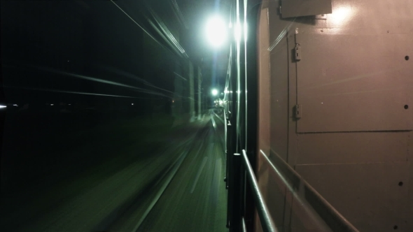 Night Train Departs From The Platform And Goes In The Night.