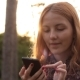 Red-haired Young Girl Using Cell Phone - VideoHive Item for Sale
