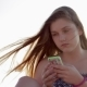 Teen Girl Using Smartphone On The Beach. - VideoHive Item for Sale