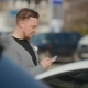 The Young Man Costs On The Parking And Something Looks In Phone. - VideoHive Item for Sale