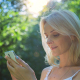 Beautiful Girl Using SmartPhone Enjoying the Sun in City Park 3 - VideoHive Item for Sale