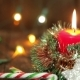One Burning Candle And Christmas Decorations - VideoHive Item for Sale