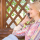 Happy Beautiful Girl Sitting on the Bench and Talking on the Phone 5 - VideoHive Item for Sale
