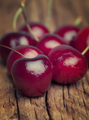 Close up of fresh cherries berries on an old wood - PhotoDune Item for Sale
